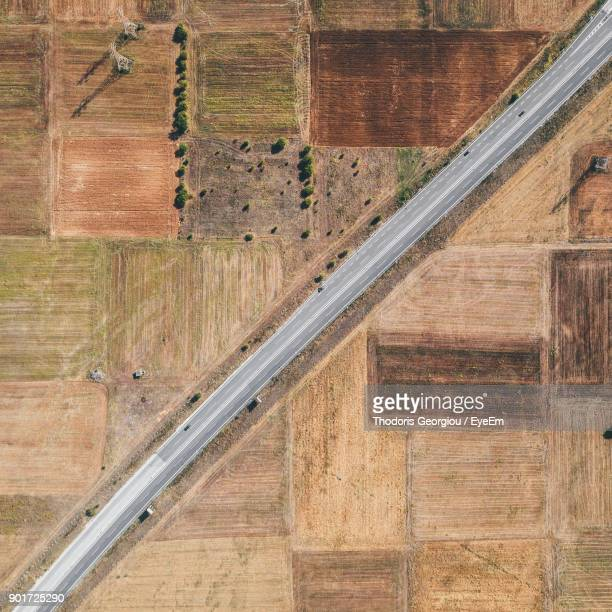 aerial view of road amidst field - macedonia country stock pictures, royalty-free photos & images