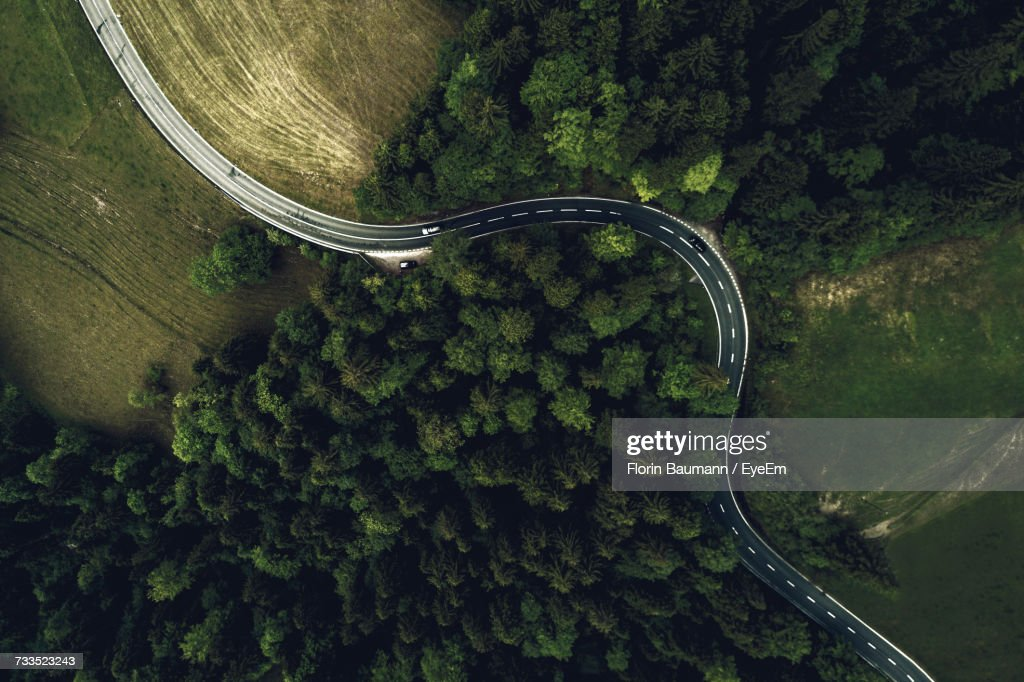 Aerial View Of Road Amidst Trees In Forest : Stock Photo
