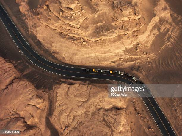 Aerial view of road among rock formations in desert, Golog, Qinghai Province, China