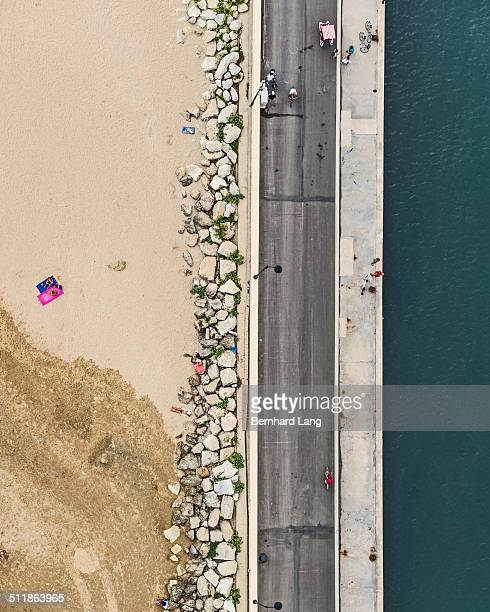 Aerial view of road between beach and sea