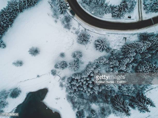 Aerial View Of Road By Snow Covered Land During Winter