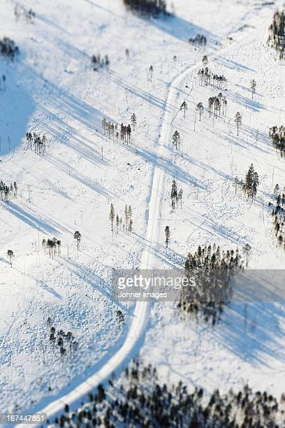 Aerial view of road covered by snow at winter