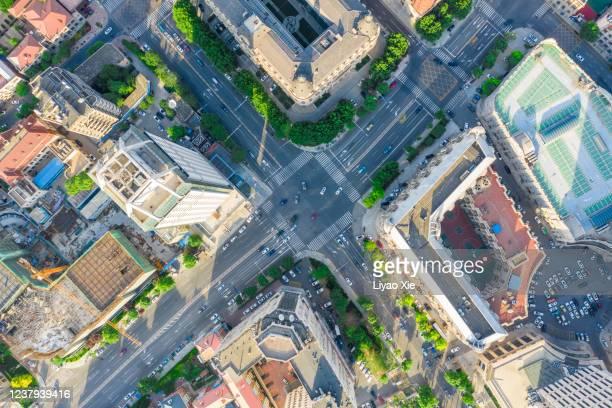 aerial view of road cross - liyao xie stock-fotos und bilder