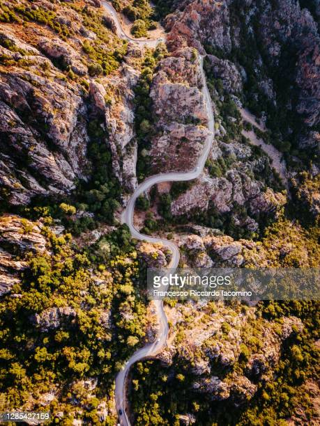 aerial view of road in calanche (calanques) of piana, gulf of girolata, corsica island, france - francesco riccardo iacomino france foto e immagini stock