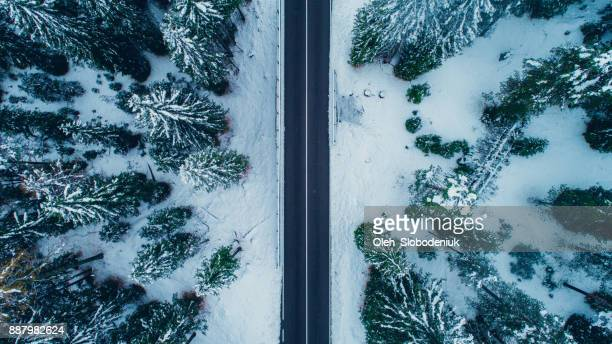 aerial view of road in winter - swiss alps stock pictures, royalty-free photos & images
