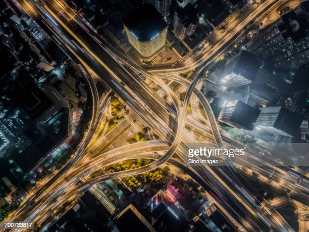 aerial view of road interchange at night - zhanjiang stock photos and pictures