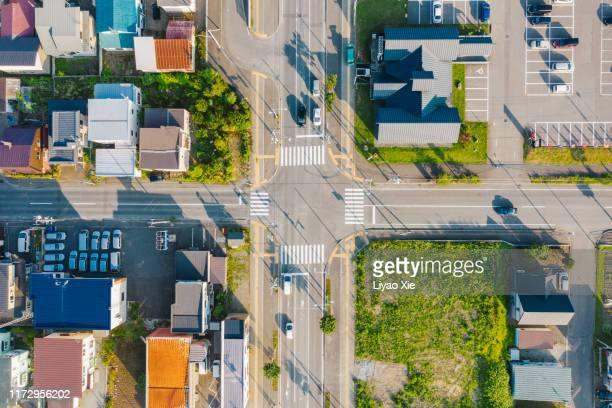 aerial view of road intersection - 住宅地 ストックフォトと画像