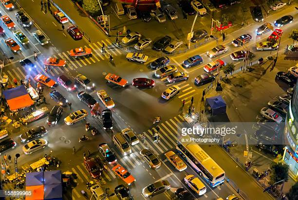 Aerial view of road intersection with traffic jam