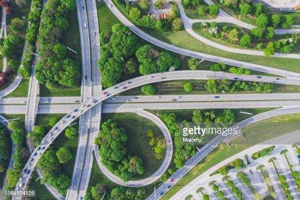 aerial view of road junction - autonomous technology stock pictures, royalty-free photos & images