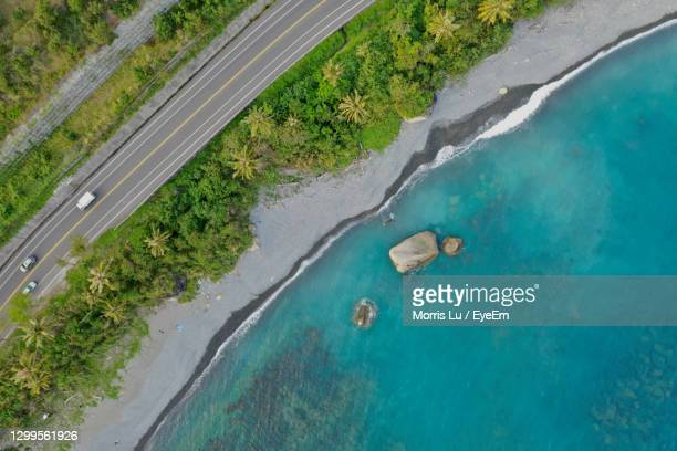 aerial view of road on cliff by sea - hualien county stock pictures, royalty-free photos & images