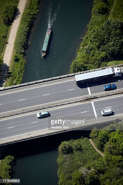 Aerial view of road over river with traffic