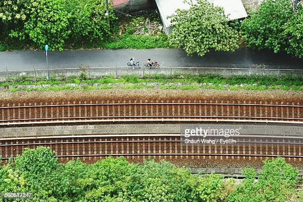 Aerial View Of Road Parallel To Railroad Tracks