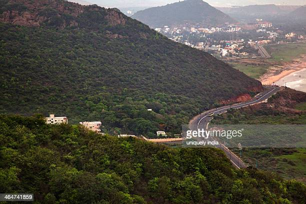aerial view of road passing through mountains, visakhapatnam, andhra pradesh, india - kailasagiri park stock pictures, royalty-free photos & images