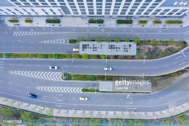 aerial view of road - liyao xie stock pictures, royalty-free photos & images