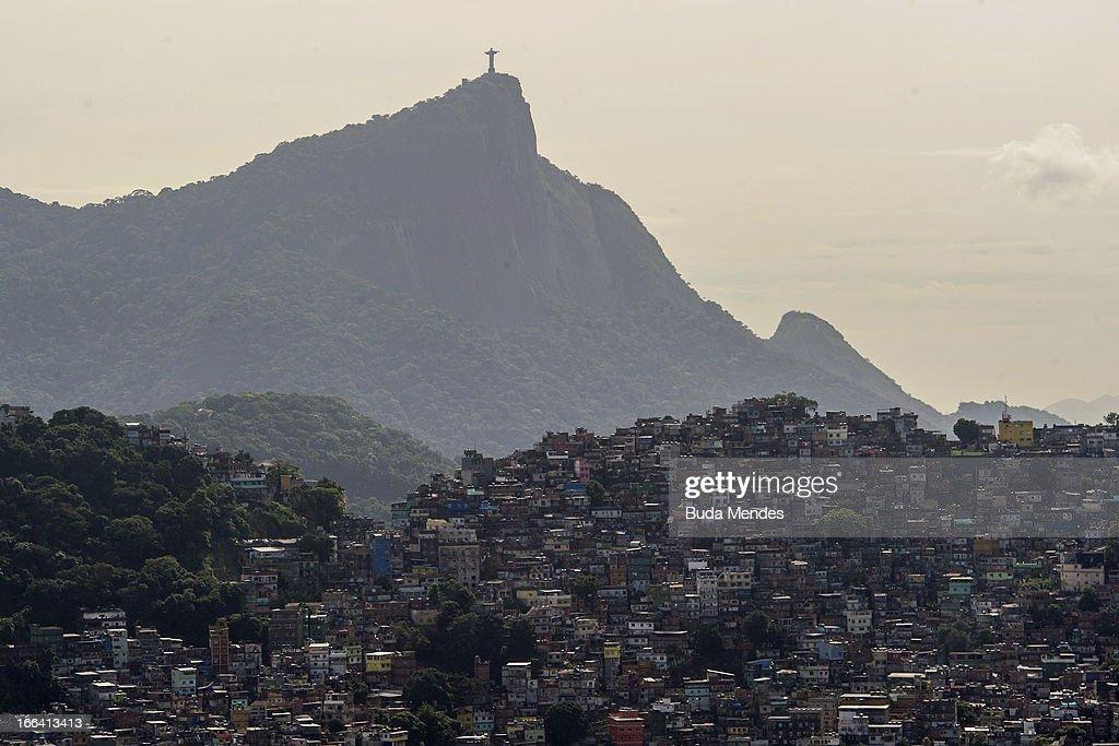 Aerial view of Rocinha shantytown (Favela da Rocinha) and Corcovado mountain on April 11, 2013 in Rio de Janeiro, Brazil.