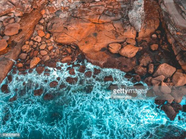 aerial view of rocky coastline, bondi beach, new south wales, australia - coastline stock pictures, royalty-free photos & images