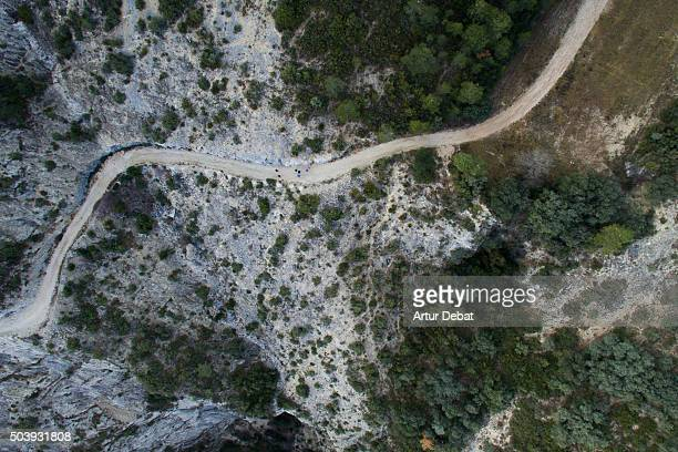 Aerial view of rocky mountain path with people in the Pyrenees mountains.