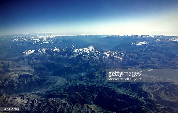 Aerial View Of Rocky Mountains Against Blue Sky On Sunny Day