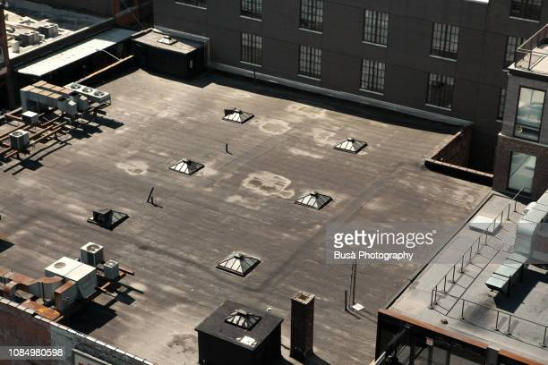 aerial view of rooftop of building with tiny skylights, manhattan, new york city - roof stock pictures, royalty-free photos & images