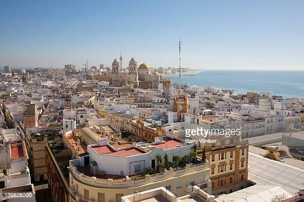 aerial view of rooftops of cadiz, andalucia, spain, from torre tavira, also known as marquesses of recano palace, looking towards the atlantic ocean - cádiz stock pictures, royalty-free photos & images