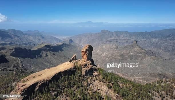 aerial view of roque nublo, a volcanic rock in caldera of tejeda, gran canaria, canary islands, spain. - tejeda canary islands stock pictures, royalty-free photos & images