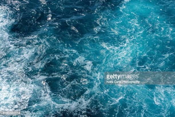 aerial view of rough sea waves - acqua foto e immagini stock
