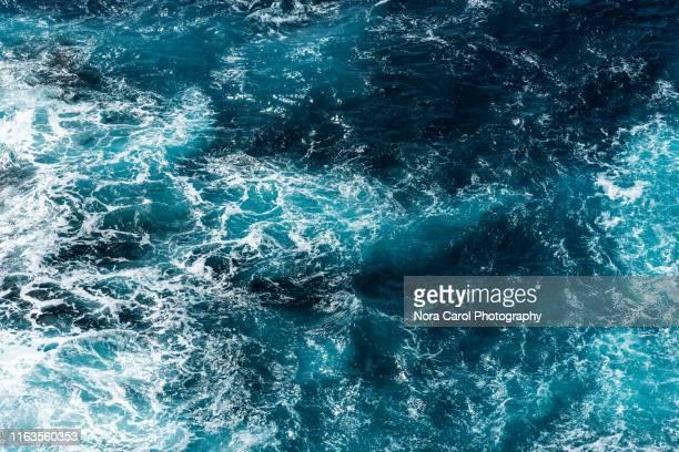 aerial view of rough sea waves - wasseroberfläche stock-fotos und bilder