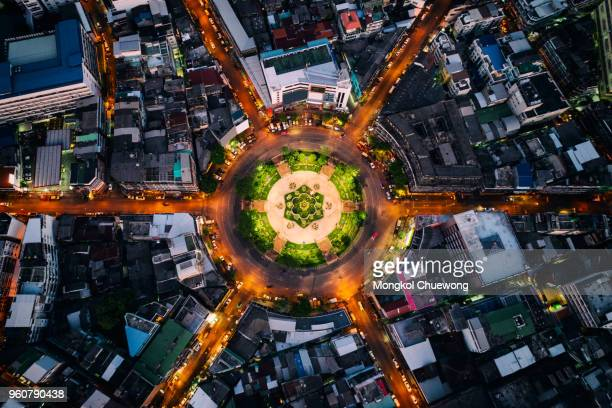 Aerial view of roundabout or circle of road with light trails on the road at night in Bangkok,Thailand. Expressway, Highway, Motorway, Tollway at Bangkok city downtown.