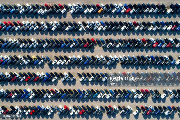 aerial view of rows of cars - car park stock pictures, royalty-free photos & images