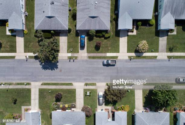 aerial view of rows of houses - town stock pictures, royalty-free photos & images