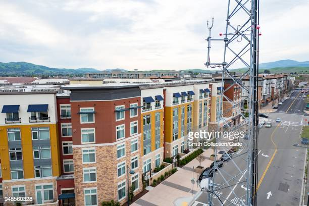 Aerial view of rows of new housing with a cellular phone tower in the foreground near the Bay Area Rapid Transit station in downtown Dublin...