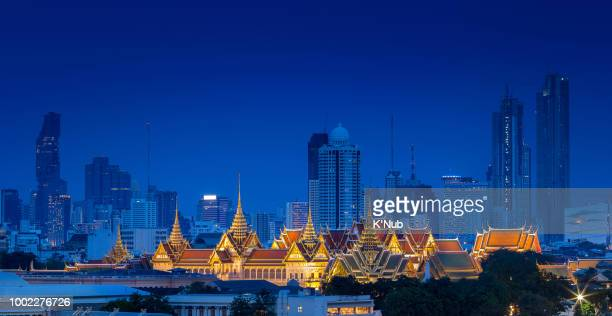 Aerial view of Royal Grand Palace on Bangkok, Thailand with luxury skyline, and condo in downtown at night after sunset time