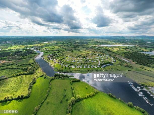 aerial view of rural ireland with a housing estate - hill stock pictures, royalty-free photos & images