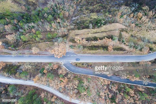 Aerial view of rural road between the autumn vegetation in the Pyrenees mountains.