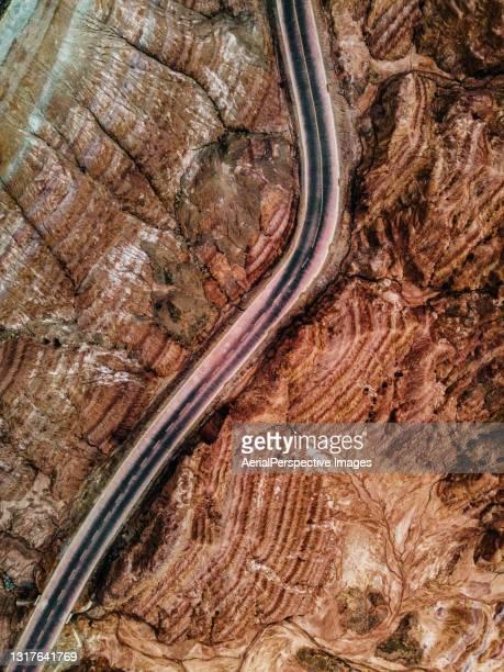 aerial view of rural road - ジオパーク ストックフォトと画像