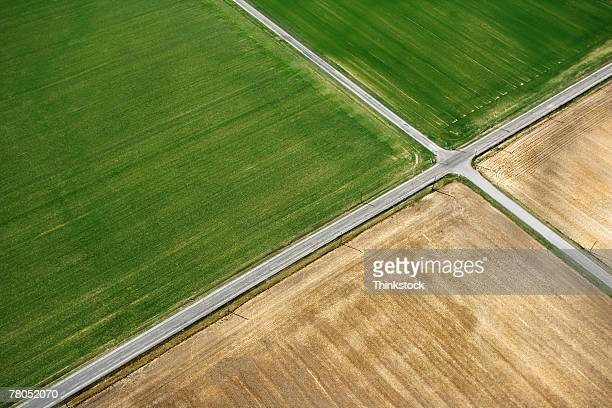 aerial view of rural roads intersecting - crossroad stock pictures, royalty-free photos & images