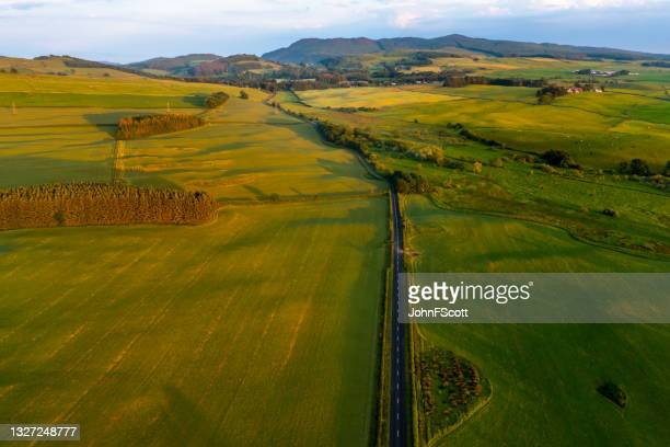 aerial view of rural scotland at sunset - johnfscott stock pictures, royalty-free photos & images
