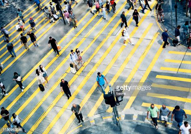 aerial view of rush hour in city crosswalk - crossing stock pictures, royalty-free photos & images