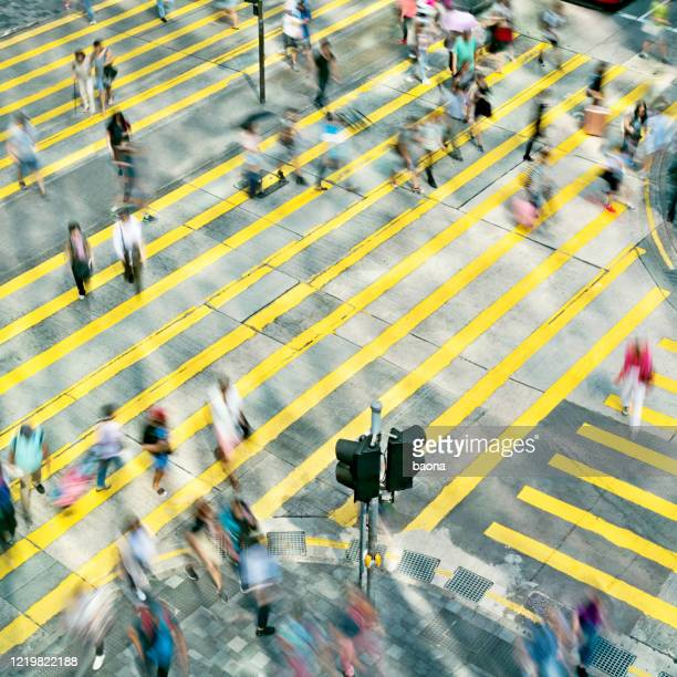 aerial view of rush hour in city crosswalk - zebra crossing stock pictures, royalty-free photos & images