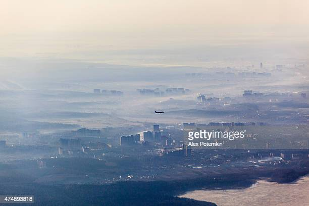 Aerial view of Russia, with haze and flying aircraft