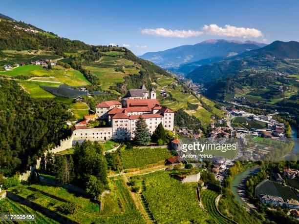 aerial view of sabiona monastery, bolzano, trentino alto adige, italy. - トレンティーノ ストックフォトと画像