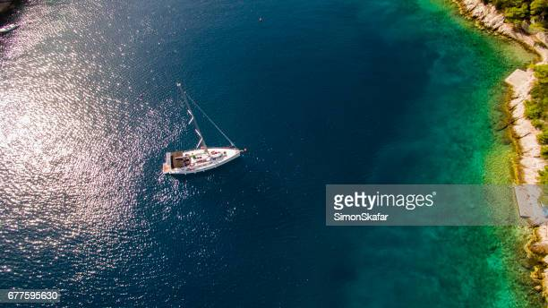 Aerial view of sail boat sailing in sea