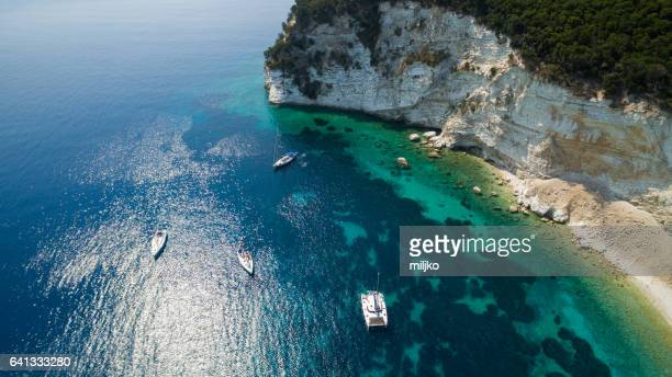 aerial view of sailboats in bay - catamaran stock photos and pictures
