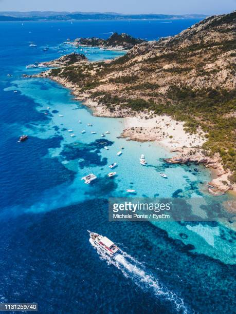 aerial view of sailboats on sea - sardinia stock pictures, royalty-free photos & images