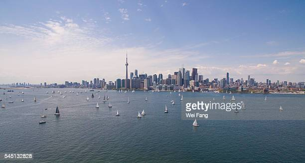 aerial view of sailing boats against toronto skyline - lake ontario stock pictures, royalty-free photos & images