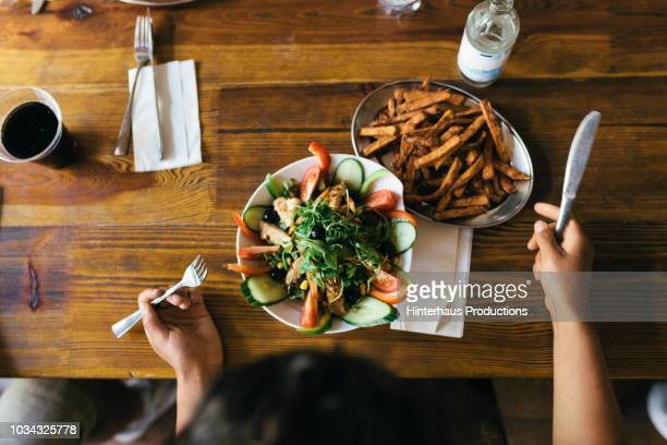 aerial view of salad and fries - vegetarian food stock pictures, royalty-free photos & images