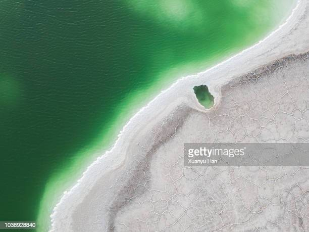 aerial view of salt lake landscape - ソルトポンド ストックフォトと画像