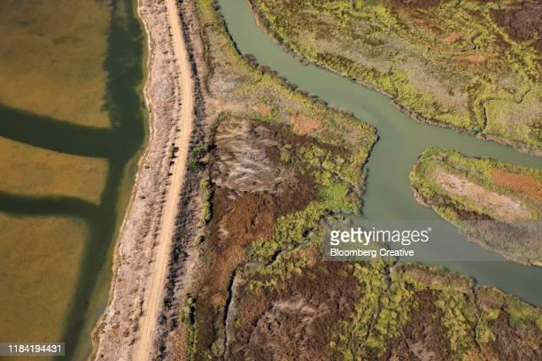aerial view of salt ponds - ソルトポンド ストックフォトと画像