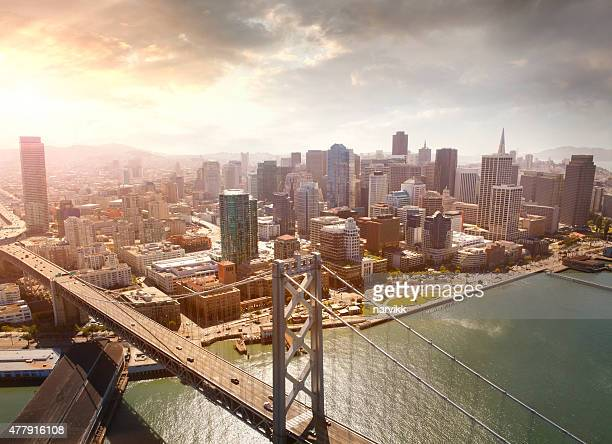 aerial view of san francisco and oakland bay bridge - san francisco california stock photos and pictures