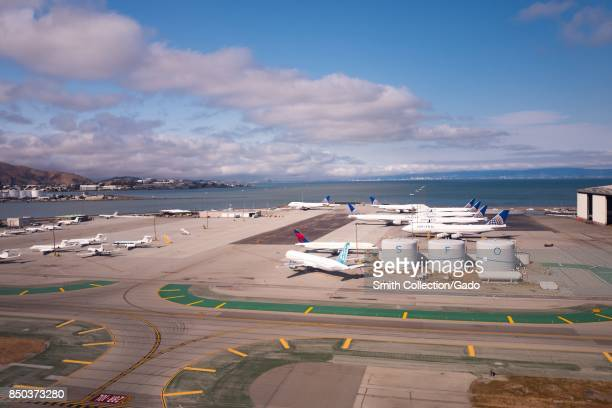 Aerial view of San Francisco International Airport San Francisco California with United Airlines jets tanks marked with the call letters 'SFO' and...